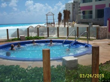 Hottubs on both sides of the pools.