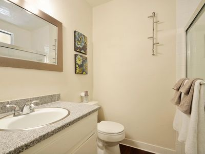 2nd bathroom. Updated granite vanities and modern white subway tile shower