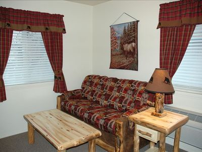 Living room area with double sofa hide-a-bed