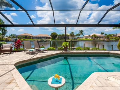 West facing pool with breathtaking view over wide saltwater canal