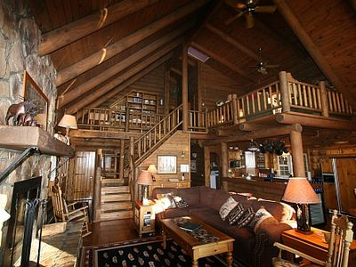 This is a true log home with wide open loft and valted ceilings
