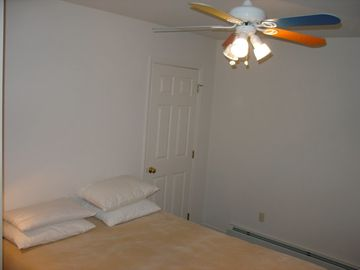 One of the 3 bedrooms upstairs - queen-size bed, closet, toddler bed, dresser