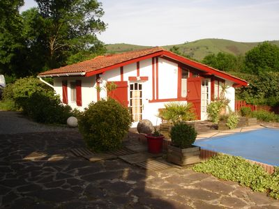 cottage with terrace, near swimming pool, mountain views.