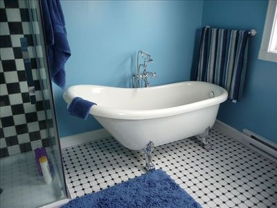 Master bath with clawfoot tub and shower