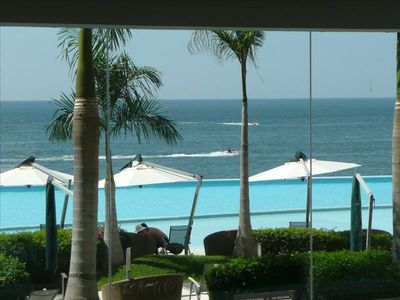 View of pool deck and ocean