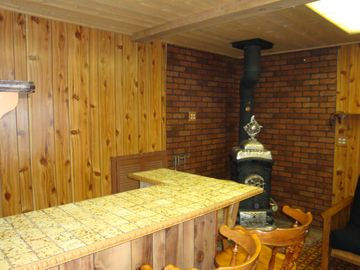 Bar and Fireplace in Gameroom