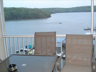 Osage Beach condo photo - Table on deck overlooking the lake and state park