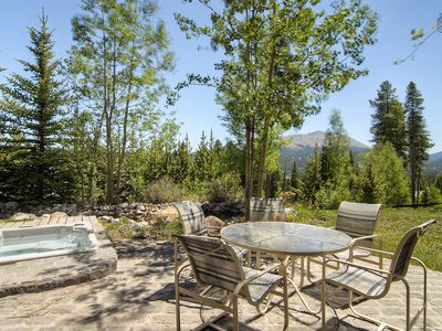 Enjoy great views from the back patio and sunken hot tub!