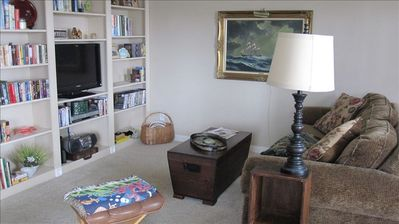 Pull-out couch, bedding in coffee table/chest, new Flat Screen T.V, books/movies
