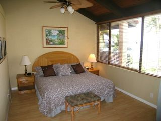 Lahaina condo photo - Spacious Master Bedroom with King bed, beautiful views of ocean overlooking pool