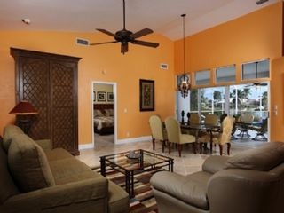 Vacation Homes in Marco Island house photo - Spacious living room with dining and a wide waterfront view
