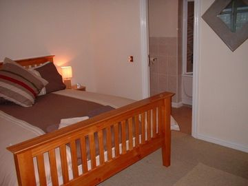 Ensuite bedroom with kingsize bed