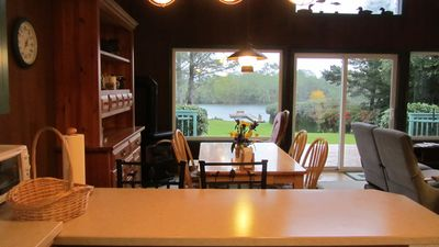 Cozy dining room with gas stove and look out the quiet lake