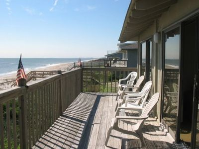 Oceanfront deck runs length of home
