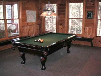 The terrace level houses a quality pool table, big TV, game table and wood stove