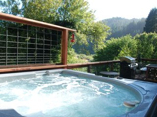 Russian River house photo - View of deck from hot tub outside living room & dining area