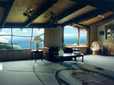 Hobbit living room & bay seat with panoramic coastal view.