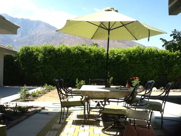 Large outdoor shaded dining table with views, views, views.