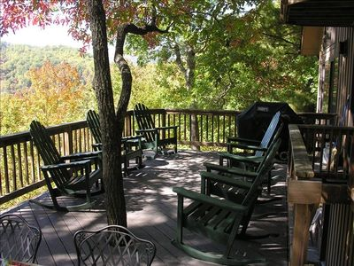 Our deck has plenty of seating and an outdoor dining table (and a tree)