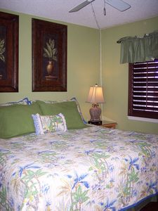 Another view of King bed, Plantation shutters