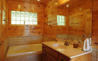 Watauga Lake cabin photo - Both bathrooms have jetted tubs, tiled floors and showers, and rain shower heads