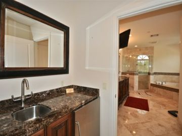 Master bedroom bathroom. Has Jacuzzi tub w/jets, flatscreen, shower, bidet, toil