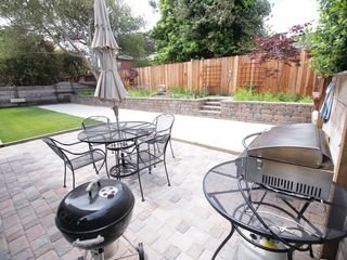 Pacific Grove house photo - Fenced backyard with seating and gas and charcoal barbecues.
