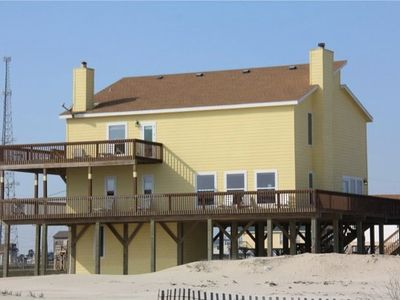 House from ocean side. Upstairs deck opens from Master bedroom
