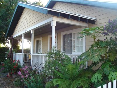 1550 sq.ft. -Front view of sunny porch - step out and  you're 4 walking mins.from beach and city restaurants and shops