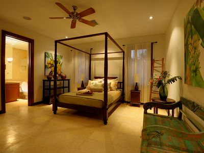 Bedroom 4 - First floor with pool courtyard view. Queen size bed.