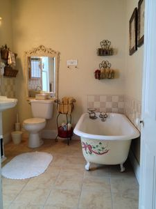 The upstairs hall bath has a claw-footed tub and separate shower.
