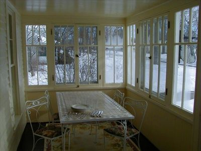 Enjoy meals on the seasonal glassed-in porch