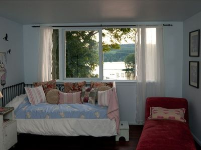 Great lake view from master bedroom which includes day bed seen here.