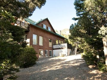 Taos house rental - Southern elevation with glimpse of the huge upper view deck