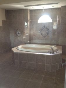 Crystal River house rental - Partial View of Master Bath with Triple Shower Heads. Dual sinks/Cherry Cabinets