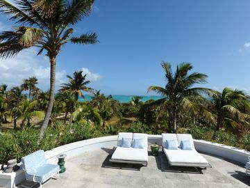 Patio with ocean views, 100 feet from your pink-sand beach.