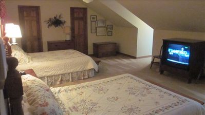 Upstairs master with 2 queen beds.