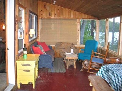 Screened porch off the other cabin - picnic table is great for family dinners.