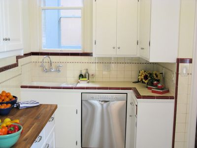 Kitchen features original refinished cabinets and brand new dishwasher.