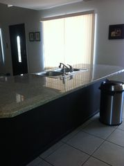 Phoenix house photo - Modern kitchen granite counter.
