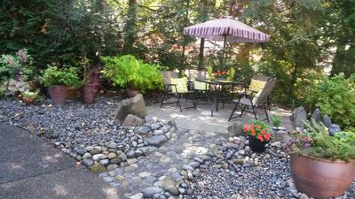 The communal patio at the foot of our stairs.