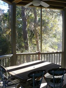 Main level screened porch  w/ dining for 6 to 8 & glider; listen to the waves