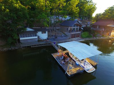 Cabin on the left sleeps 8 & the boathouse on the right sleeps 4! Covered dock!