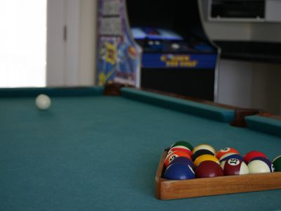 Rodanthe house rental - Pool Table with more arcade games in the background
