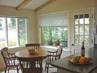 Orleans house photo - Second dining area in kitchen, with views, adjacent to flowering greenhouse
