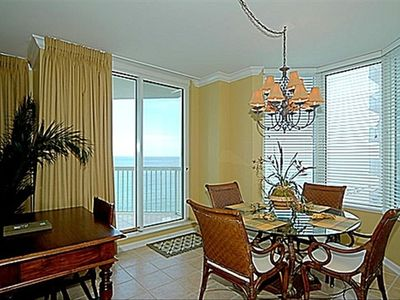 Dining area with beach view and balcony access. Open to Living Rm and Kitchen