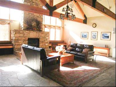 Gateway Lodge lobby with large stone fireplace that warms you up apres ski.