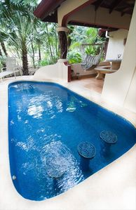 Relax in the pool under the Giant Guanacaste Tree