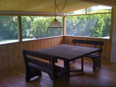 Screened in porch perfect for dining and relaxing