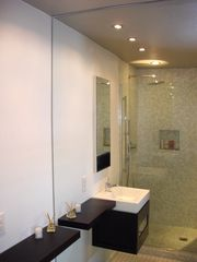 Palm Springs condo photo - Master bath with glass enclosure and floating vanity.